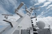 stock photo of passenger ship  - Satellite communication antenna on the top of large passenger ship - JPG