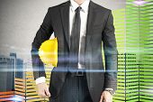 stock photo of efficiencies  - Man architect currency savings and energy efficiency - JPG