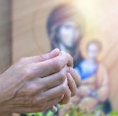 image of repentance  - Lonely women praying with rosary in hands - JPG