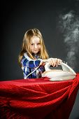stock photo of cinderella  - Cute little girl helping your mother by ironing clothes childhood concept - JPG