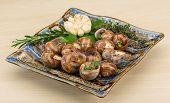 stock photo of escargot  - Escargot with rosemary thyme garlik and melissa - JPG