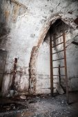 pic of ww2  - Old abandoned empty bunker interior with white walls and rusted constructions - JPG
