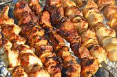 stock photo of kebab  - Shish kebab on skewers and hot coals - JPG