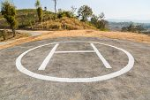 stock photo of rescue helicopter  - Helicopter pad on remote mountain - JPG