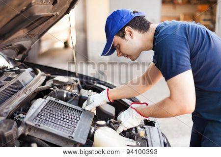Mechanic using a wrench to repair a car engine