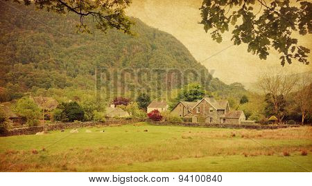 Village in Lake District, Cumbria. UK.  Photo in retro style. Added paper texture.