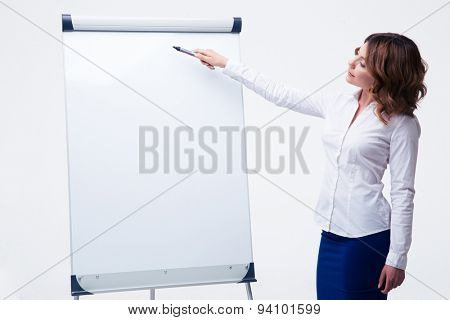Beautiful businesswoman presenting strategy on flipchart isolated on a white background