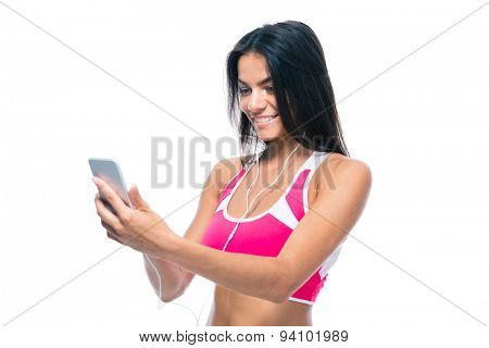 Happy woman listening music on smartphone in headphones isolated on a white background