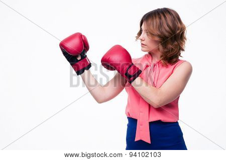 Cute elegant woman with boxing gloves isolated on a white background. Looking away