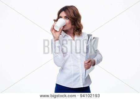 Businesswoman holding folders and drinking coffee isolated on a white background