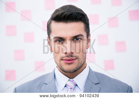 Portrait of a handsome businessman looking at camera
