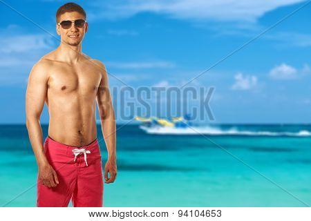 Man on beach at Maldives. Collage.