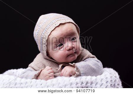Portrait of a newborn baby boy on black background