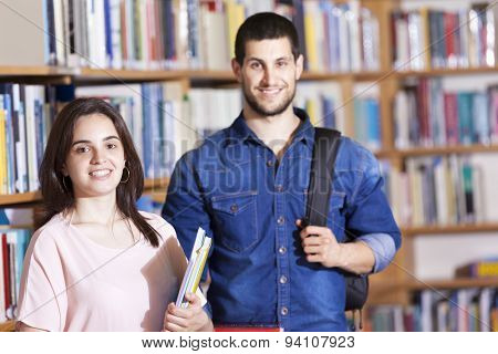 Portrait of smiling students at the library
