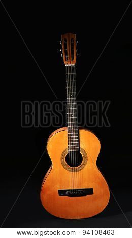Classical guitar on dark background
