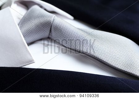 Male jacket with shirt and tie close up