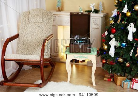 Beautiful Christmas interior with fireplace, turntable and fir tree