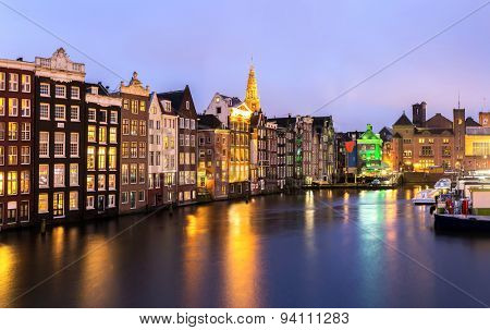 Amsterdam Canals and Saint Nicholas church at dusk Natherland