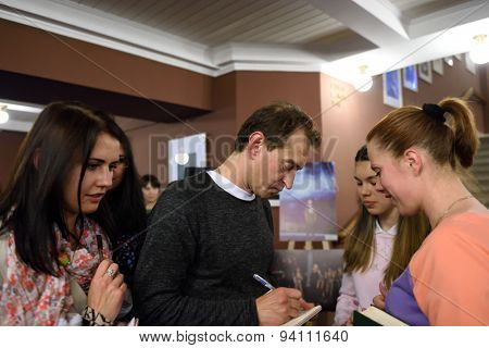 ST. PETERSBURG, RUSSIA - JUNE 19, 2015: Actor Konstantin Khabensky gives autographs after the children's charity musical