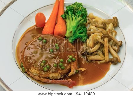 Filet Mignon With Gravy Sauce On Dish.