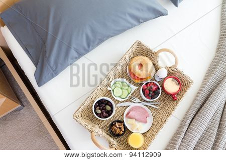 High Angle View Of Breakfast Tray On Unmade Bed