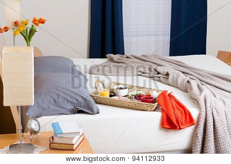 Breakfast Tray On Unmade Bed In Modern Bedroom