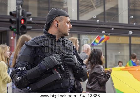 RIGA, LATVIA - JUNE 20: An unidentified guard taking part in Pride Parade 2015 on June 20, 2015 in Riga, Latvia