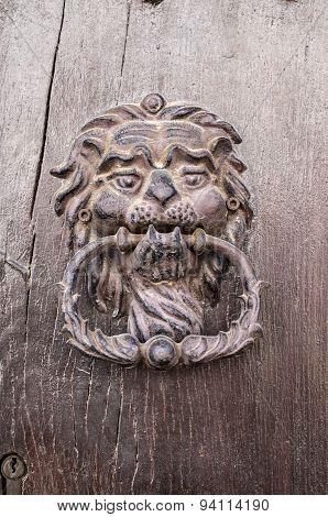 Lion Head, Door Knocker On Old Wooden Door