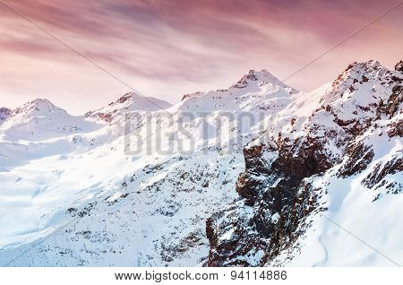 Winter Snow-covered Mountains At Sunset.