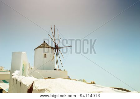 Windmill In Oia Town. White Architecture On Santorini Island, Greece.