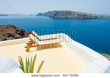 Sunbeds On The Beach. Santorini Island, Greece
