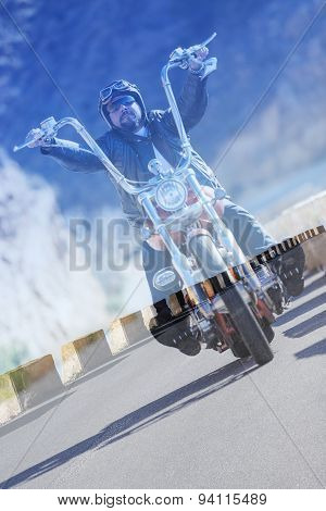 Double Exposure Chopper Motorcyclist And Asphalt Road.