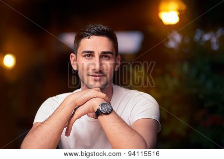 Young Man Sitting in a Restaurant