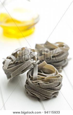 black tagliatelle pasta on kitchen table
