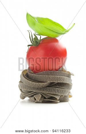tagliatelle pasta with tomato and basil leaf on white background