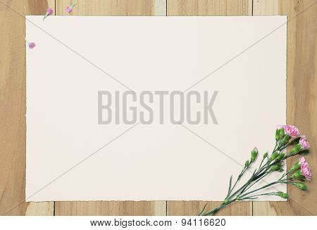 Blank White Paper And Pink Carnation On Wooden Background