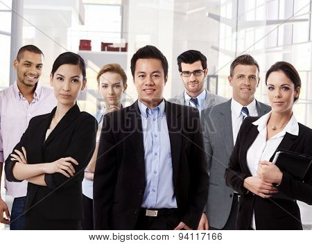 Team portrait of multi ethnic business group at office.