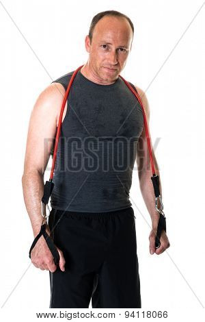 Adult man with a resistance band. Studio shot over white.