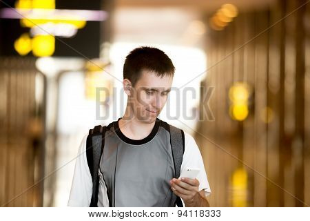 Man Using Cell Phone In Airport