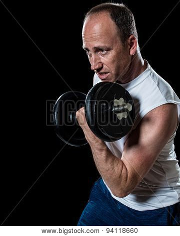 Bicep curl exercise with dumbbell. Studio shot over black.