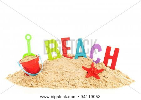 heap sand with beach items and word for vacation
