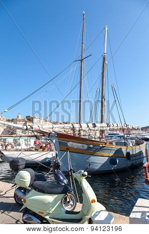 SAINT TROPEZ, FRANCE -  SEPTEMBER 16, 2008: View of Saint Tropez harbor with yachts and bikes . conc