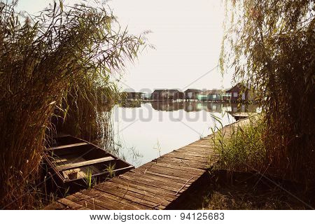 Boat Near Wooden Path On Lake