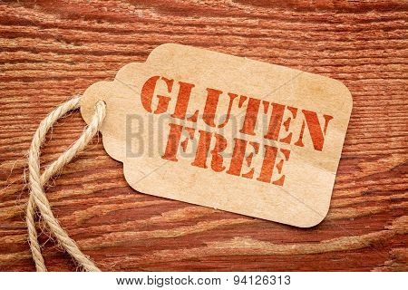 gluten free sign a paper price tag against rustic red painted barn wood