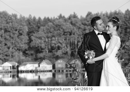 Bride And Groom Near Lake