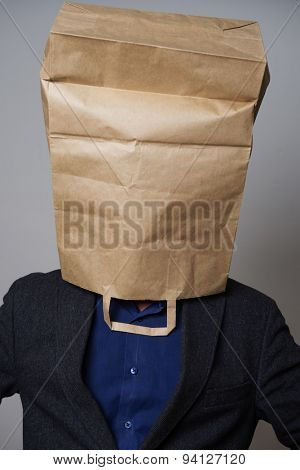 Man with a cardboard bag on his head