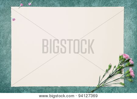 Blank White Paper And Pink Carnation On Ragging Paint Floor