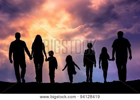 Caucasian Family Outdoor At Sunset