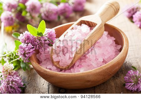 spa with pink herbal salt and clover flowers