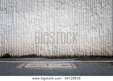 Concrete Wall And Asphaltic Road